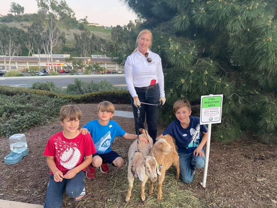 Children meet young goats at municipal outreach