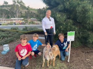 Alissa Cope with goats and children